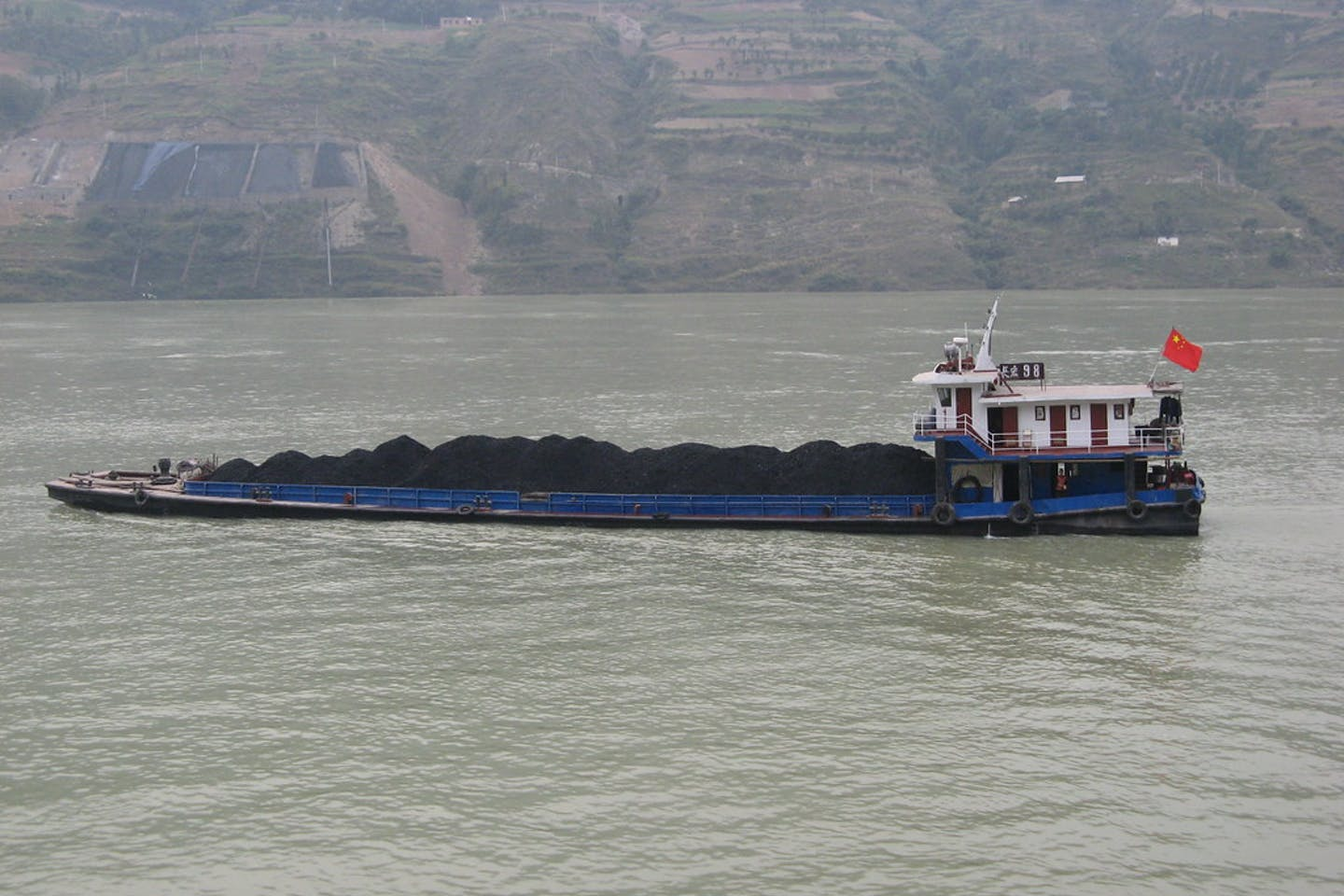 A coal barge along a river in China.