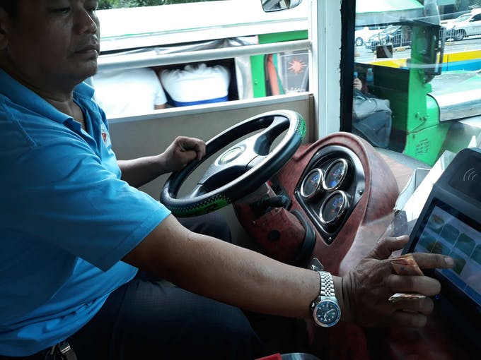 electric jeepney paying fare