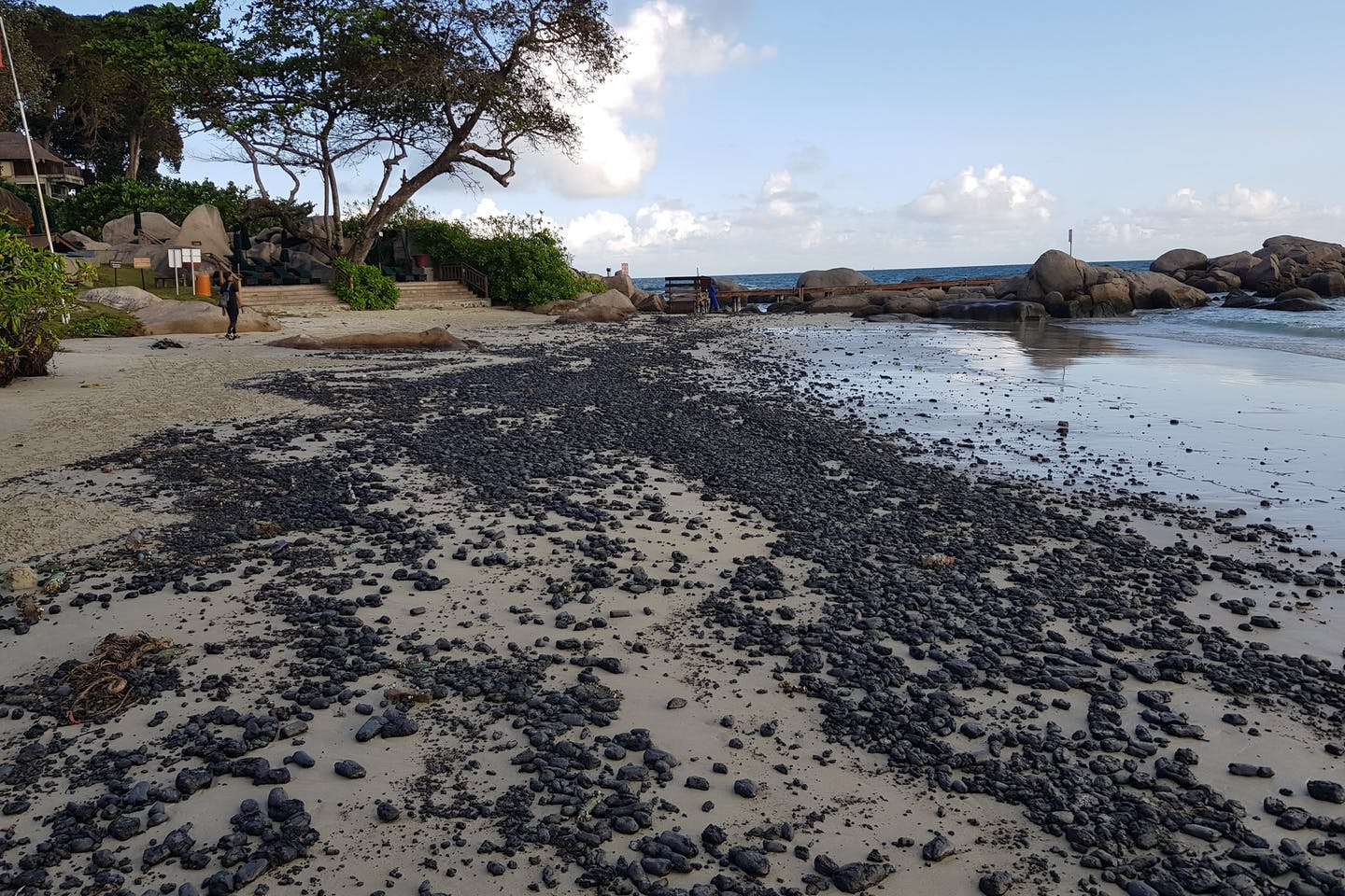 A beach covered in oily clumps in Bintan, Indonesia.