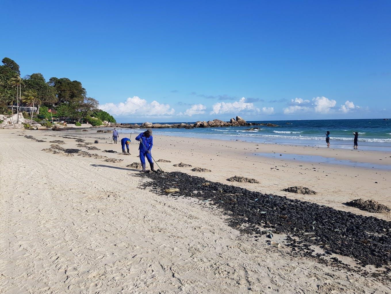 Oil clumps on a beach in the resort island of Bintan, Indonesia, near Singapore.