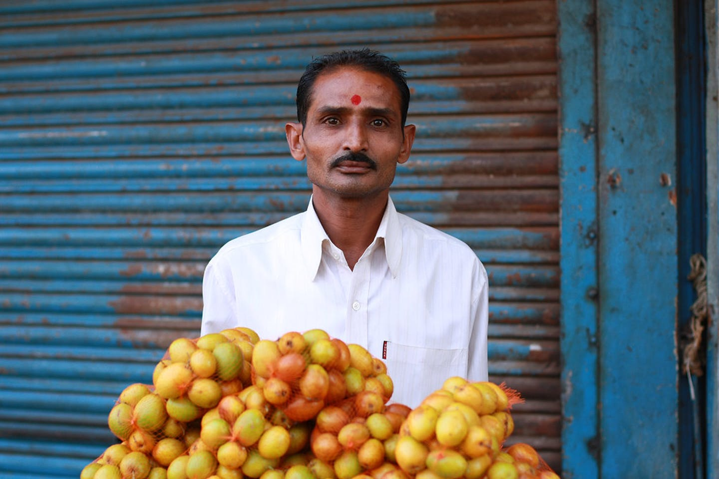 man sells vegetables in Old Ahmedabad, India