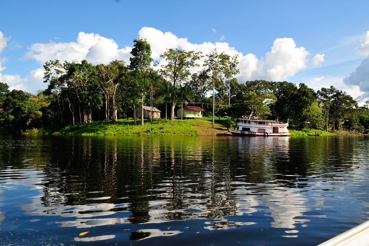 A house in the middle of a forest in the Amazon riverbank, Brazil
