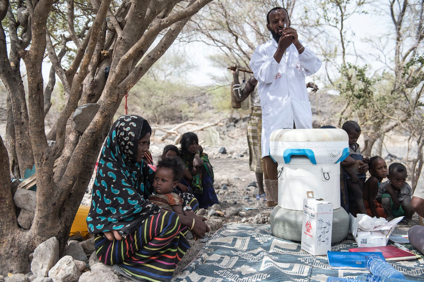 Mobile health team giving vaccines to a rural community in Ethiopia