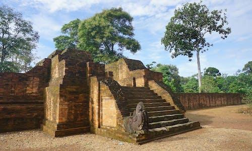 Coal piles threaten public health, ancient temple, in Indonesian village