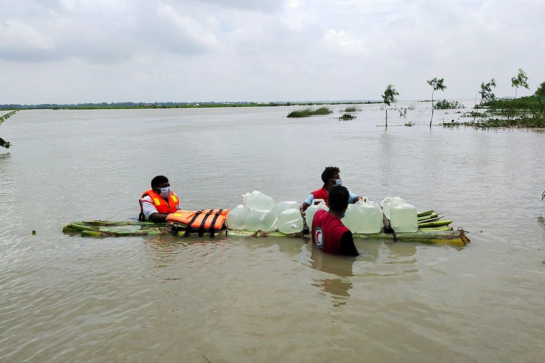 Volunteers bringing clean water to flood-stricken communities in northern Bangladesh.
