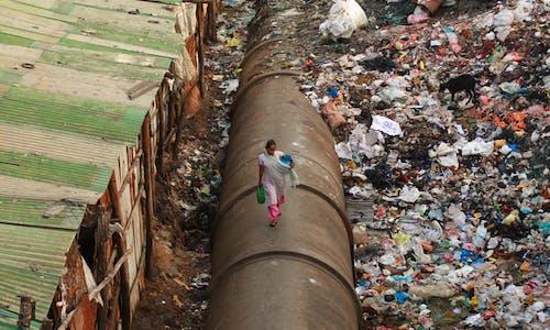 In slums and windowless apartments, Asia's poor bear brunt of coronavirus