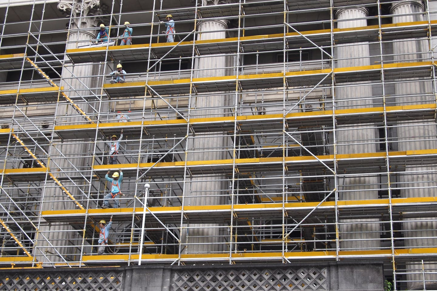 Workers on a scaffolding on a construction site in Singapore