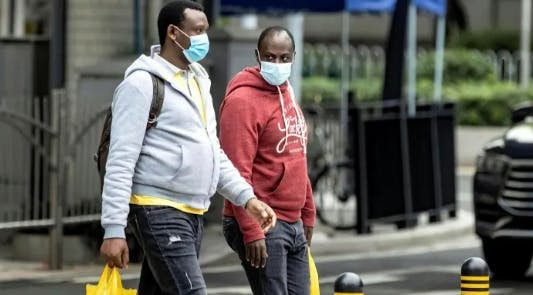 Africans in China wear face masks. Image: Alex Plaveski/EPA/Shutterstock