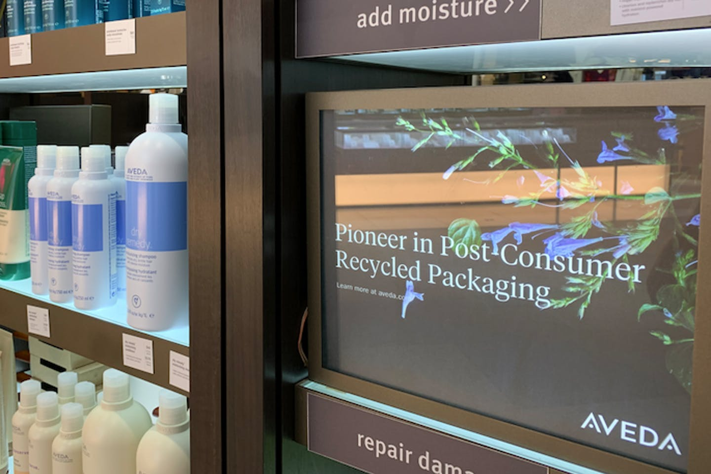 Aveda products, promoted as using post-consumer recycled plastic.