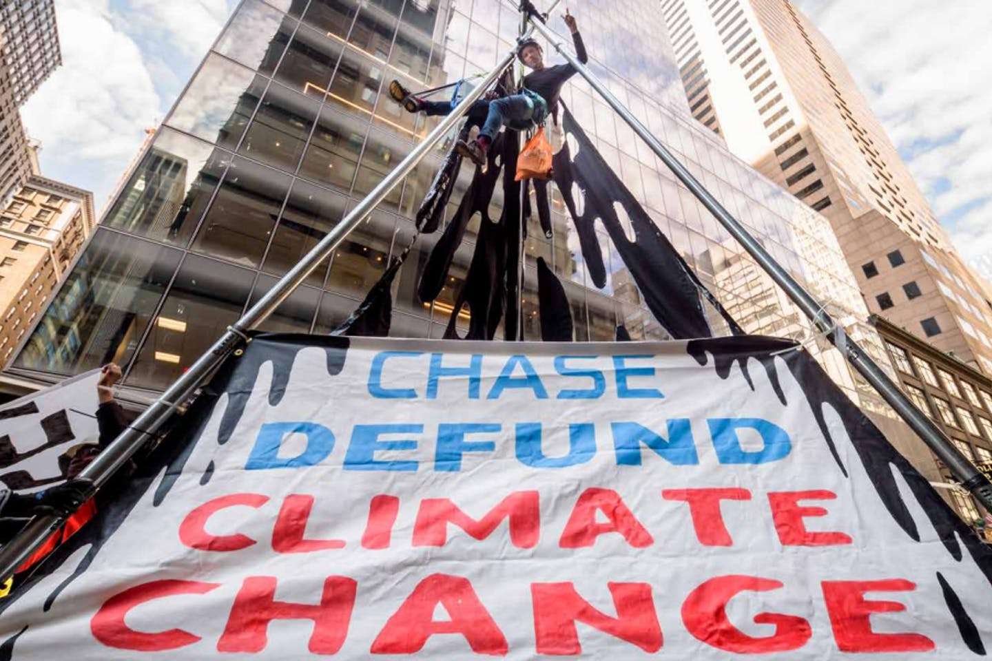 An activist protesting against JP Morgan Chase's fossil fuel financing in the United States.