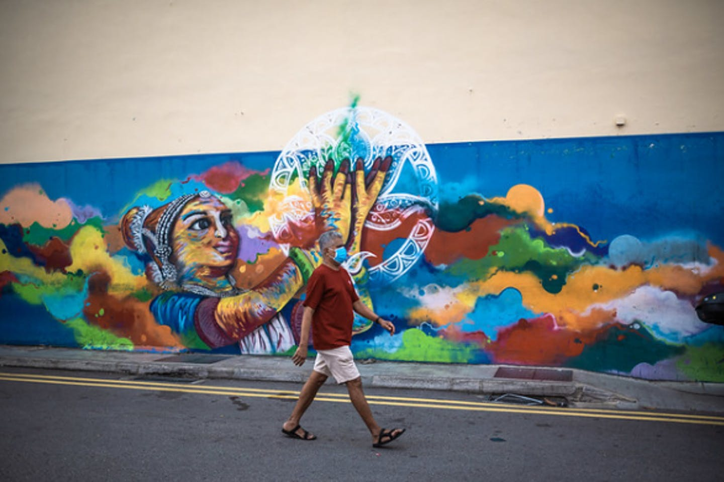A lone man walks down a usually busy street in Little India, Singapore, during the coronavirus outbreak. Image: Tim Ha/Eco-Business