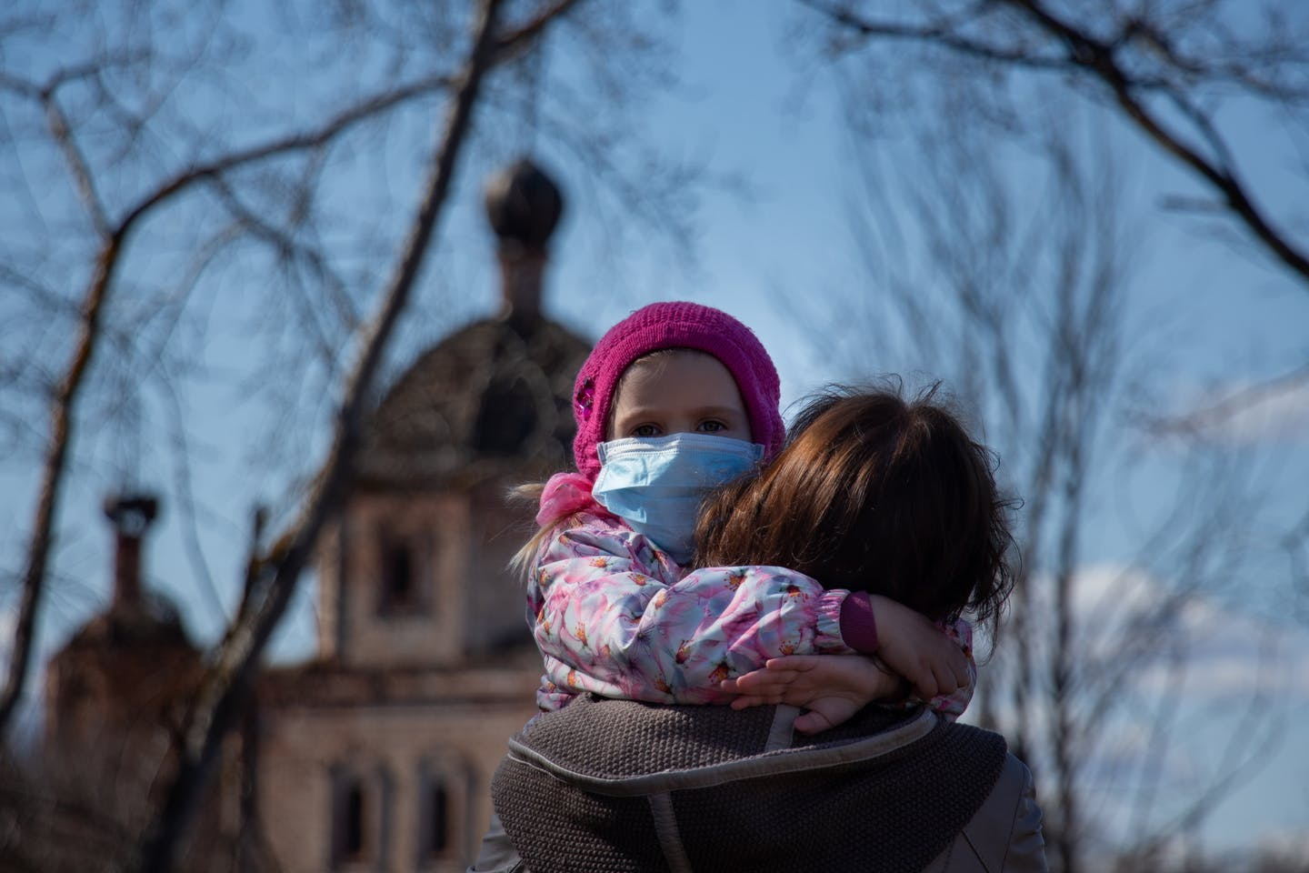 child and parent wearing masks