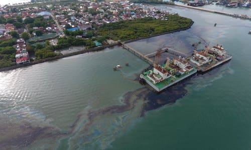 Probe underway on Iloilo oil spill, as activists call for compensation and more containment efforts by Ayala-led power firm