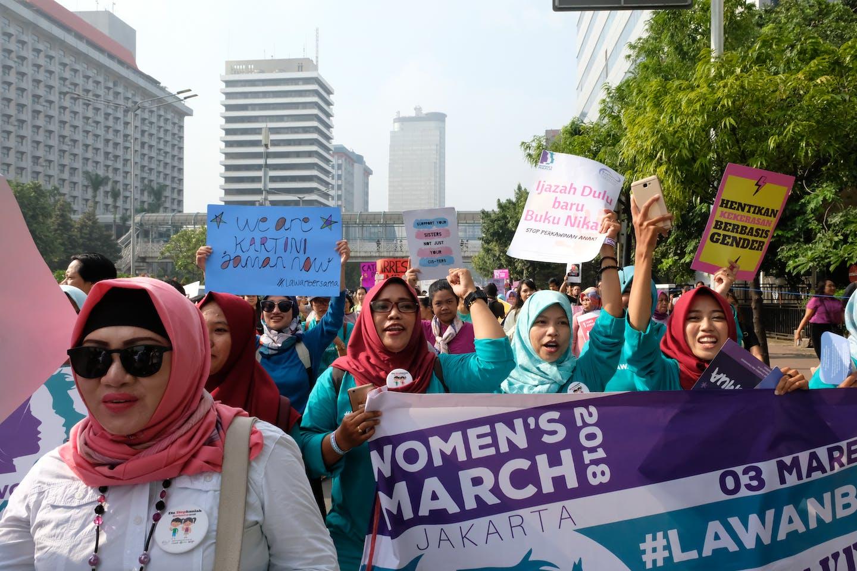 Women marching against gender-based violence in 2018