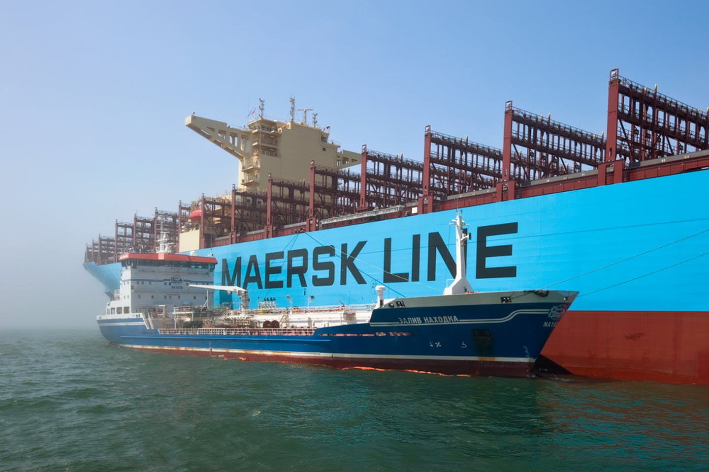 Shipping containers are transported on a Maersk Line vessel in Russia