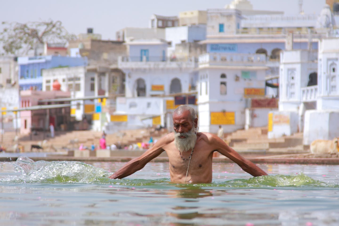 indian man bathing on a hot day