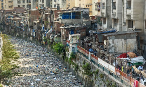 Don't forget us in coronavirus battle, say businesses in India's Dharavi slum