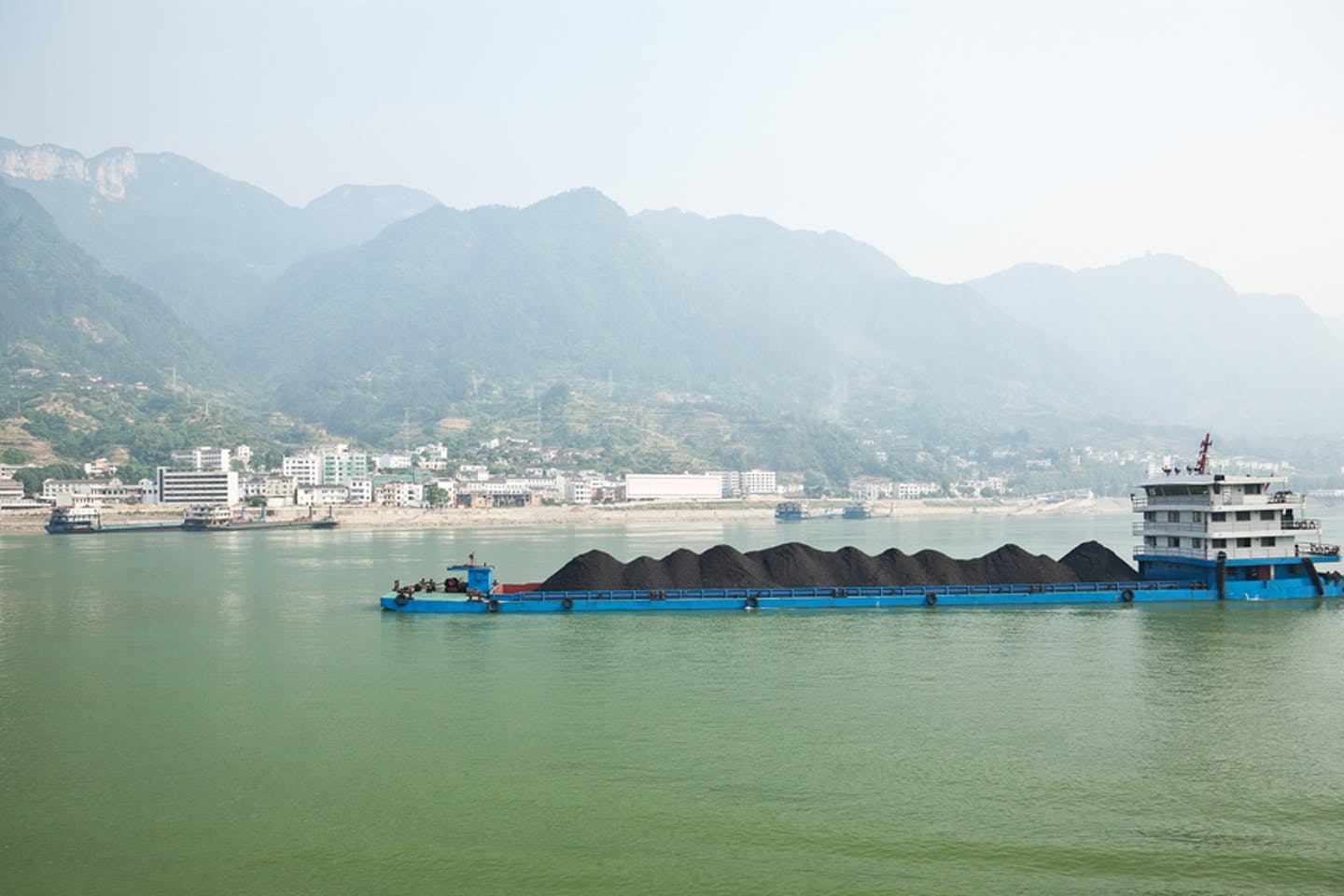 Coal barge sailing along the Yangtze river in China