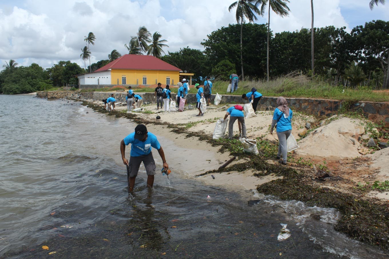 Hospitality workers clean beaches off the coast of Bintan.