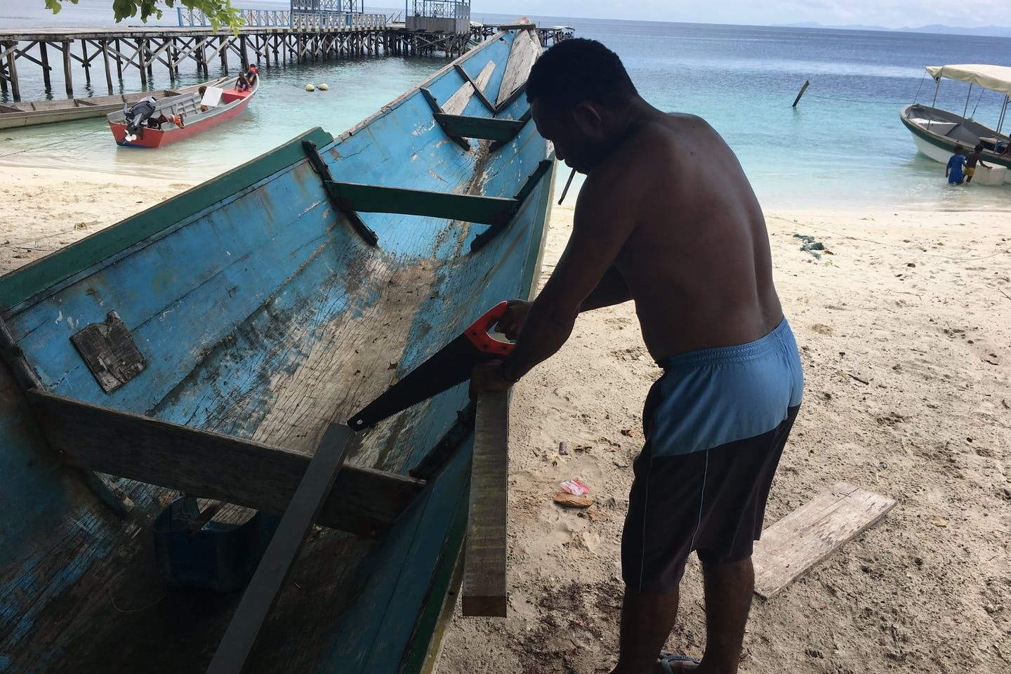 Boat maintenance by local in Papua