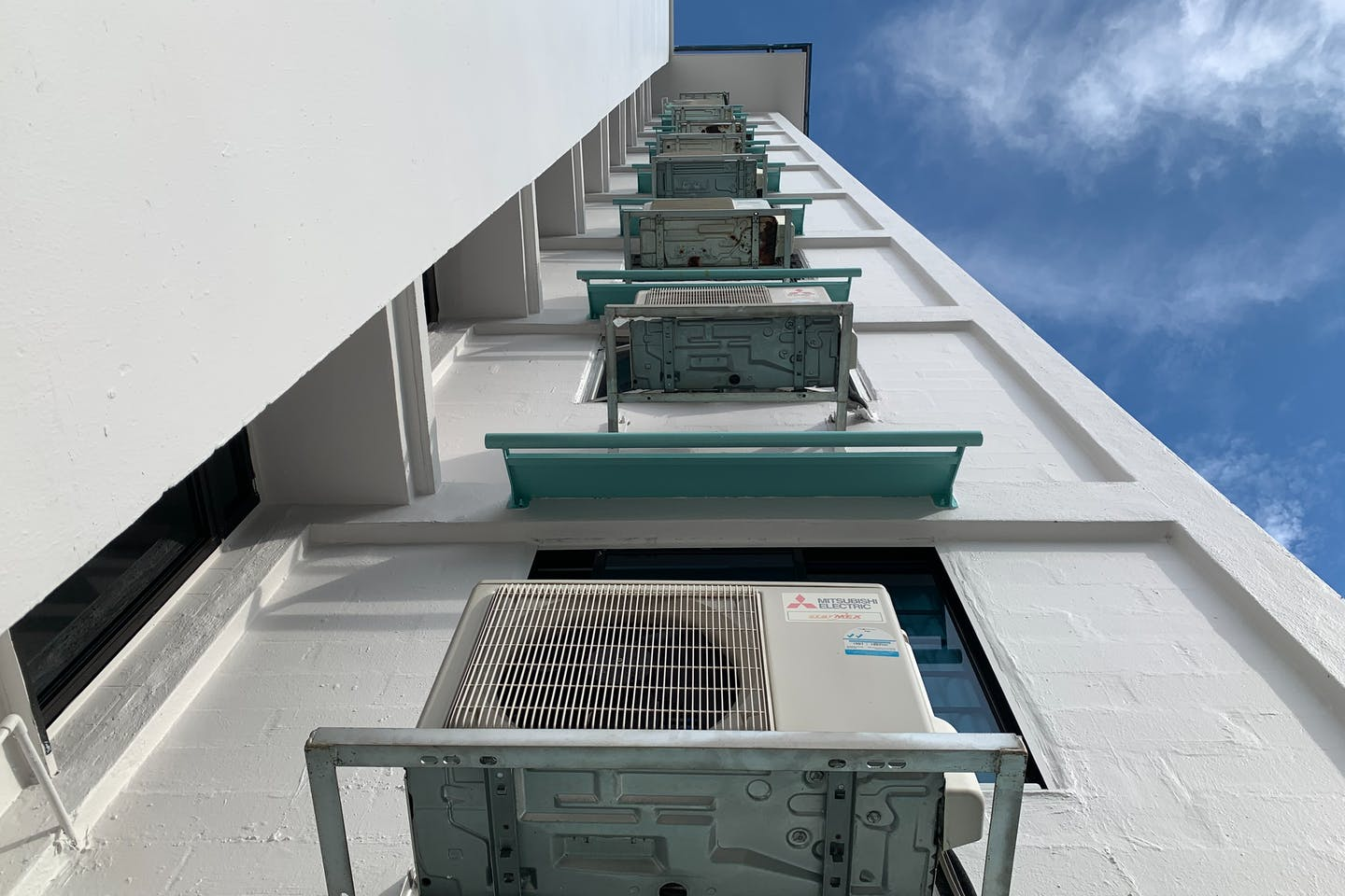Air-conditioning units on a building in Singapore. Image: Robin Hicks/Eco-Business