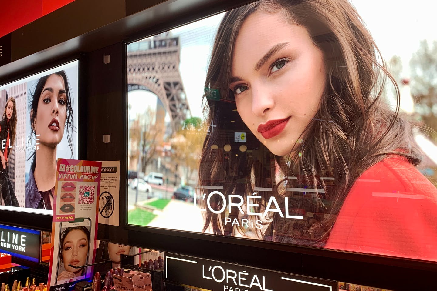 A L'Oreal display in a pharmacy in Singapore.