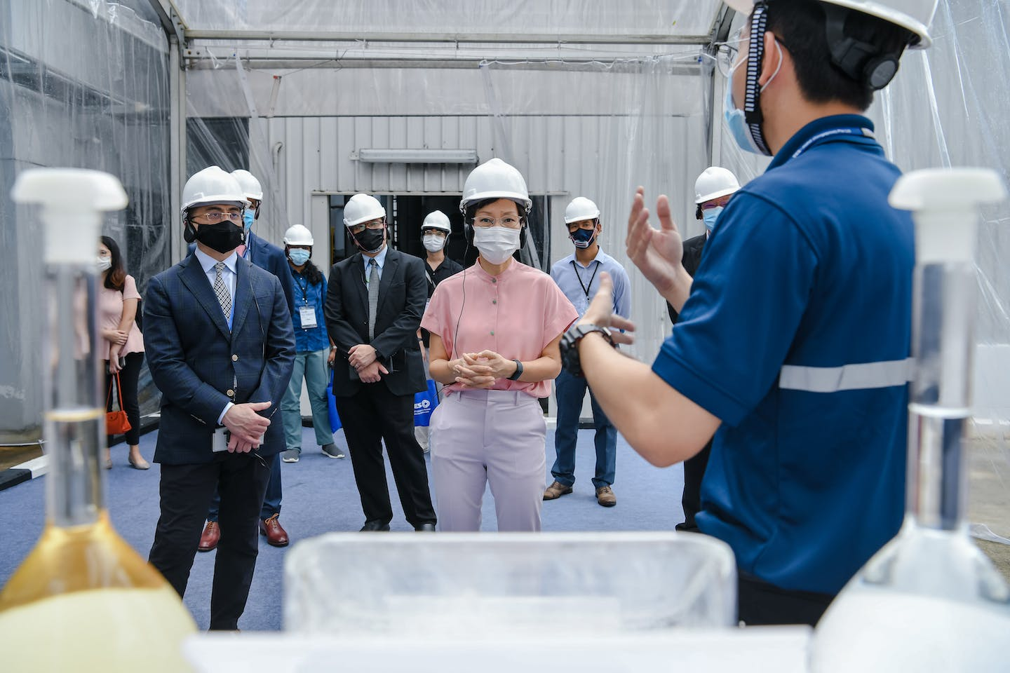 Singapore's environment minister Grace Fu (centre) is shown around the new Tes B battery recycling facility in the industrial region of Jurong.