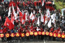 Activists want repeal of Indonesia's controversial new law, while investors warn of 'severe' environmental, human rights repercussions