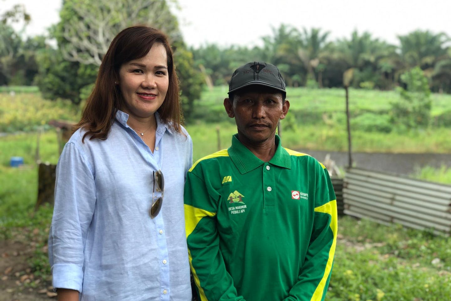 Elim Sritaba, chief sustainability officer of Asia Pulp and Paper, with Pak Suryono, a farmer who previously used slash-and-burn techniques to prepare land for cultivation. Image: APP