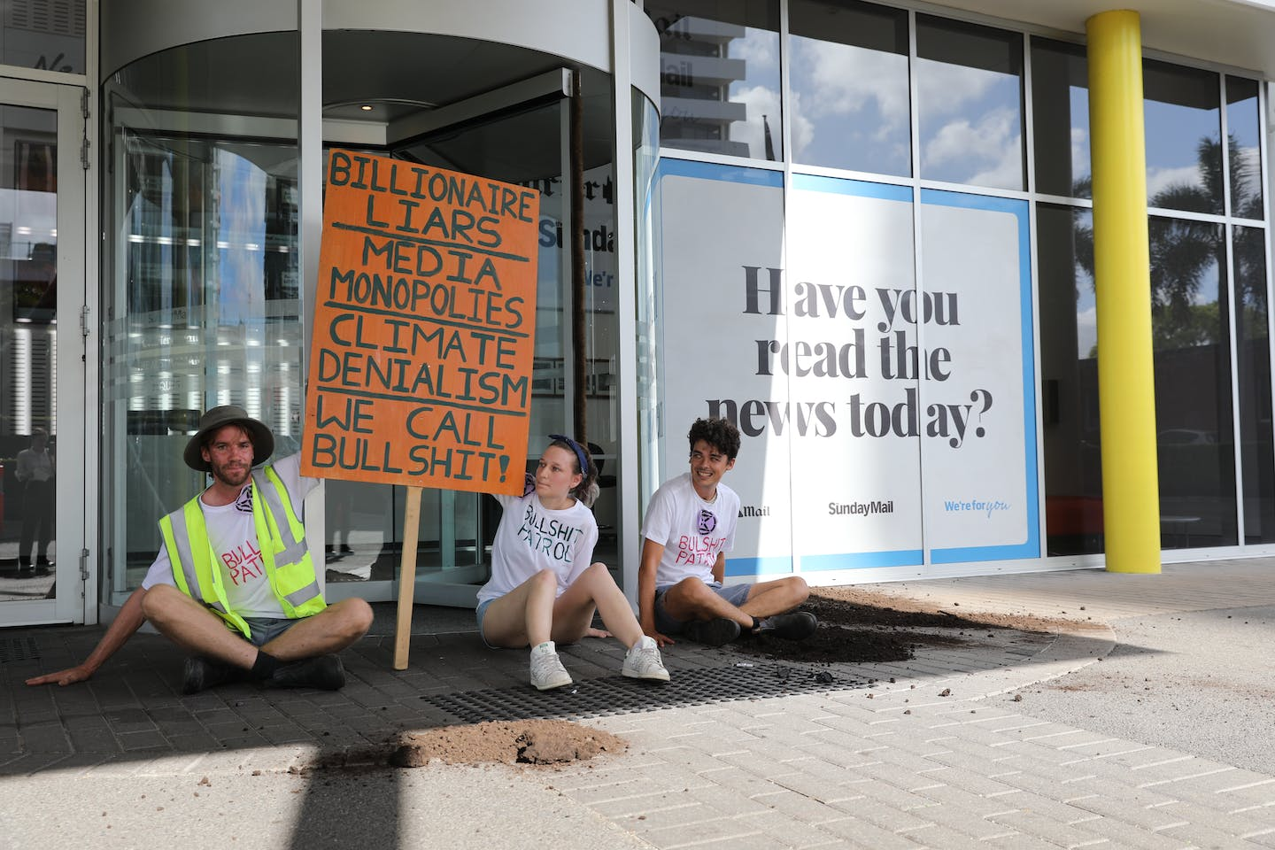 "Extinction Rebellion protesters demonstrate outside of the News Corp headquarters in Bowen Hills, Brisbane, where they deposited a truckload of manure. The protesters held banners that read: ""Billionaire liars. Media monopoly. Climate denial. We call bullshit."" Image: XR"