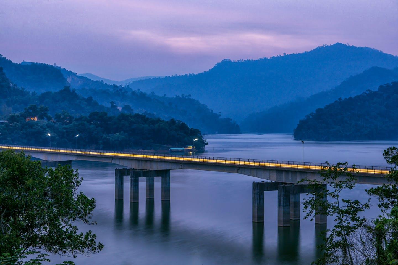A modern road skirts the Royal Belum Rainforest in Perak, Malaysia.