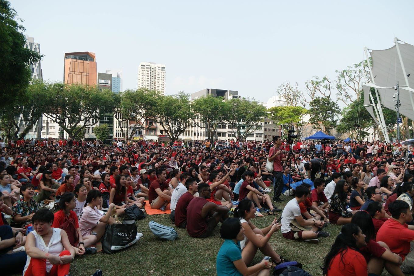 A crowd listens to speeches at SG Climate Rally