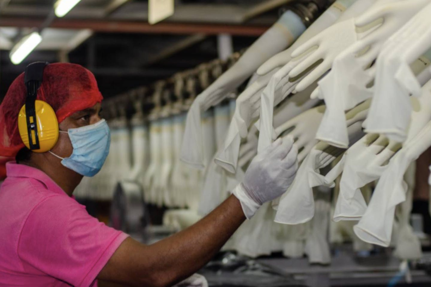 A worker makes checks at the Miditech Gloves' rubber glove factory in Malaysia in 2020.