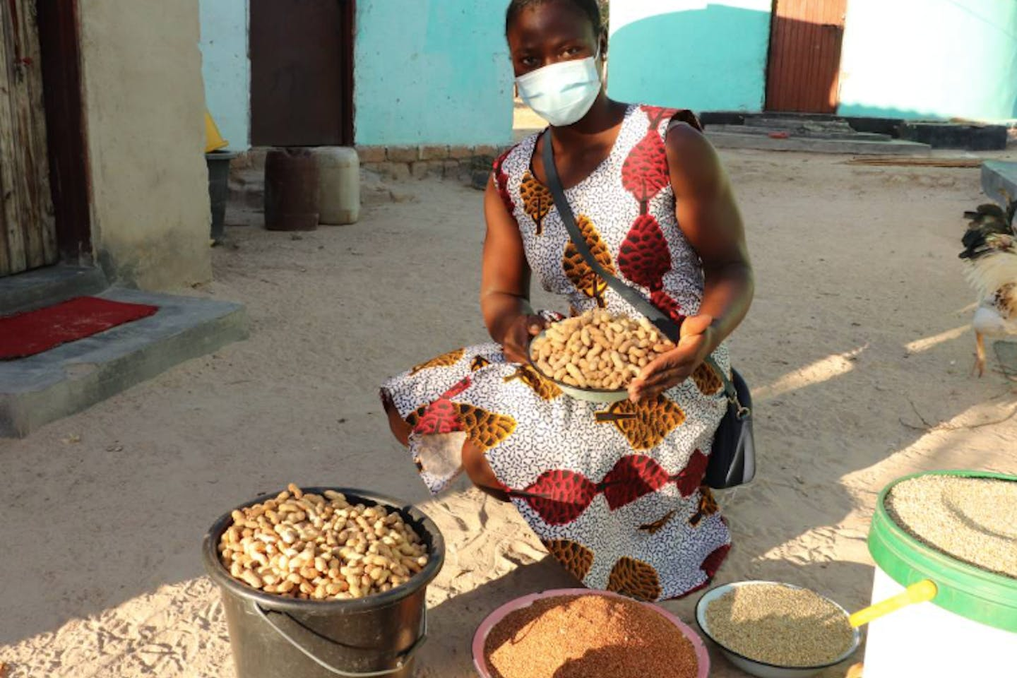 Farmer Mavis Gofa poses with grains she produced from her hometown in Mutoko, northeastern Zimbabwe