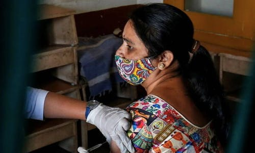Tables turn as India's female health workers get Covid jab
