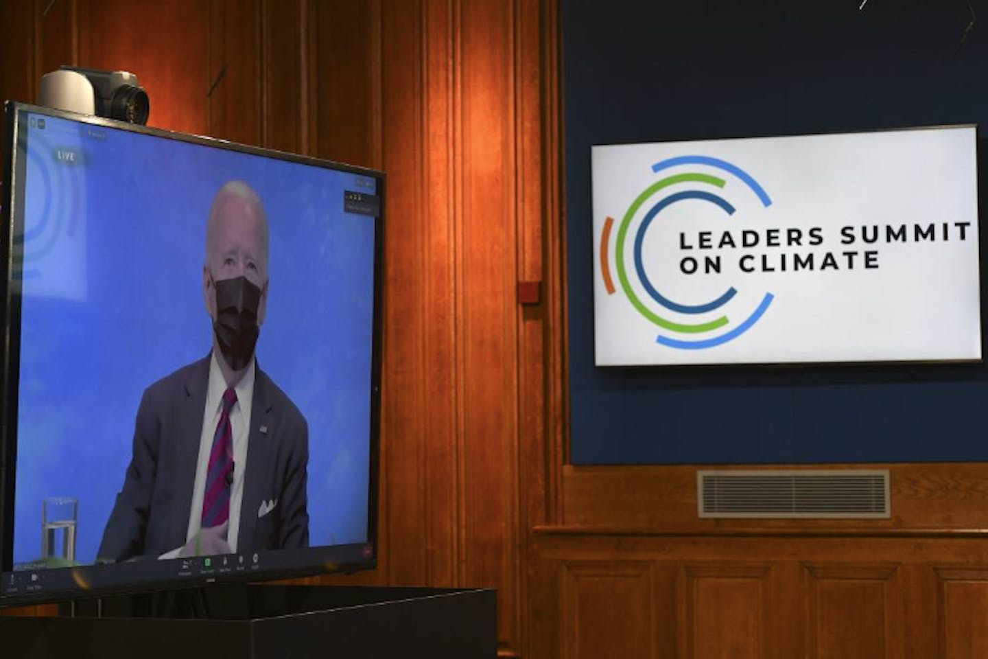 US President Joe Biden on the screen for Leaders Summit on Climate