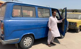 In Pakistan city, green scheme for polluting bus owners inches along