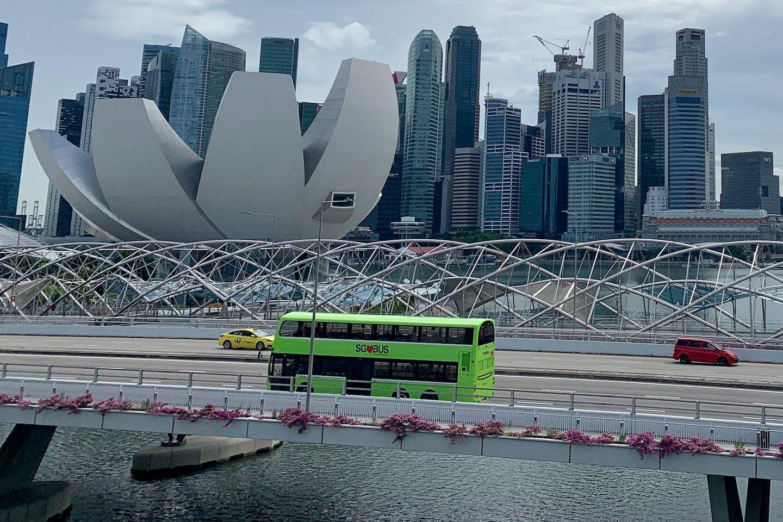 A bus heads over a bridge at Marina Bay.