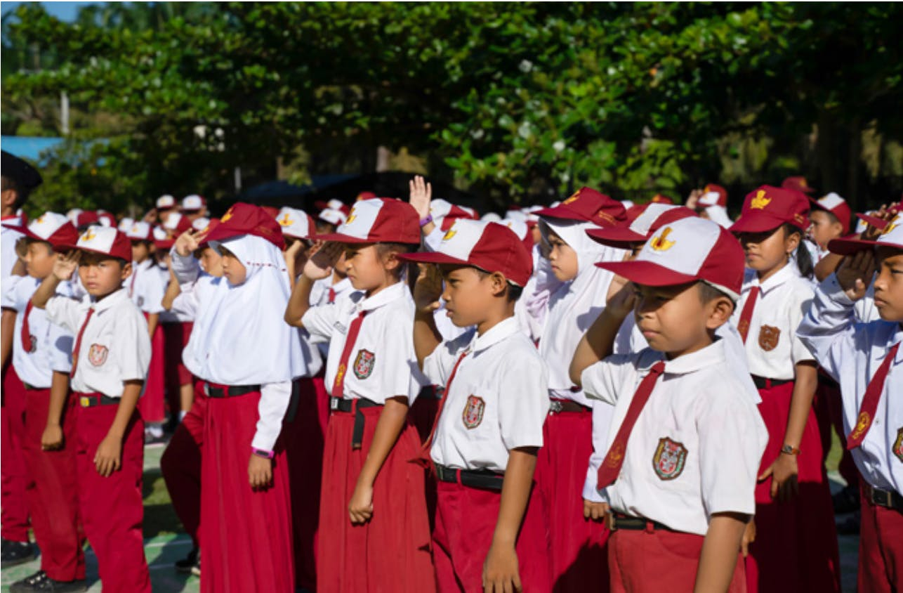 Children at roll call on a Musim Mas plantation in Indonesia