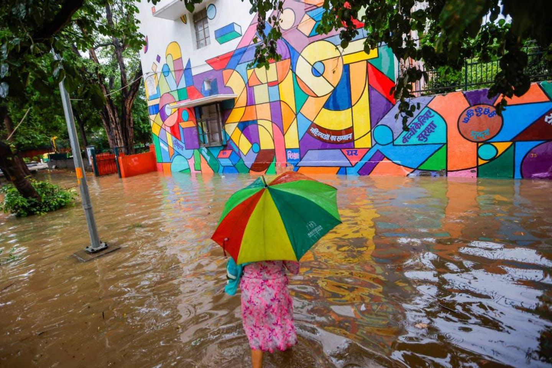 Woman walking through flooded street