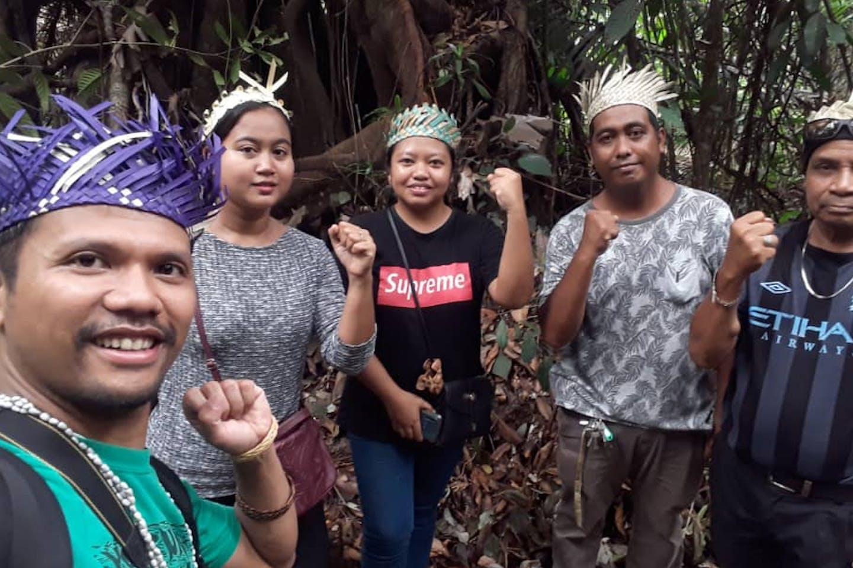 Artist and activist Shaq Koyok (left) with members of the indigenous Temuan community