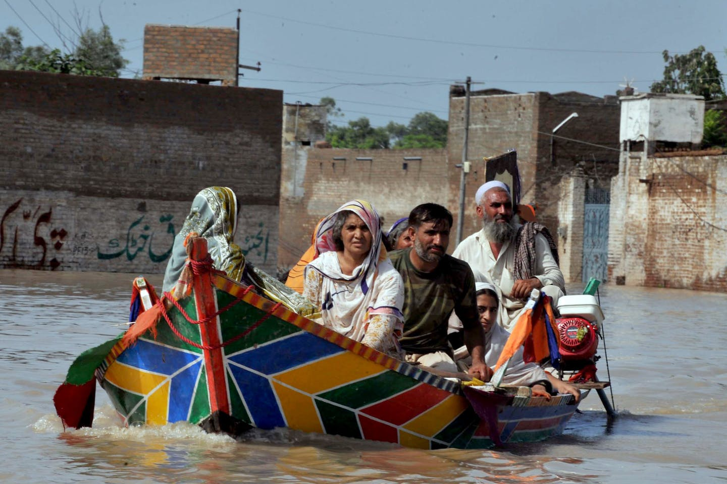 Family escaping floods in Pakistan