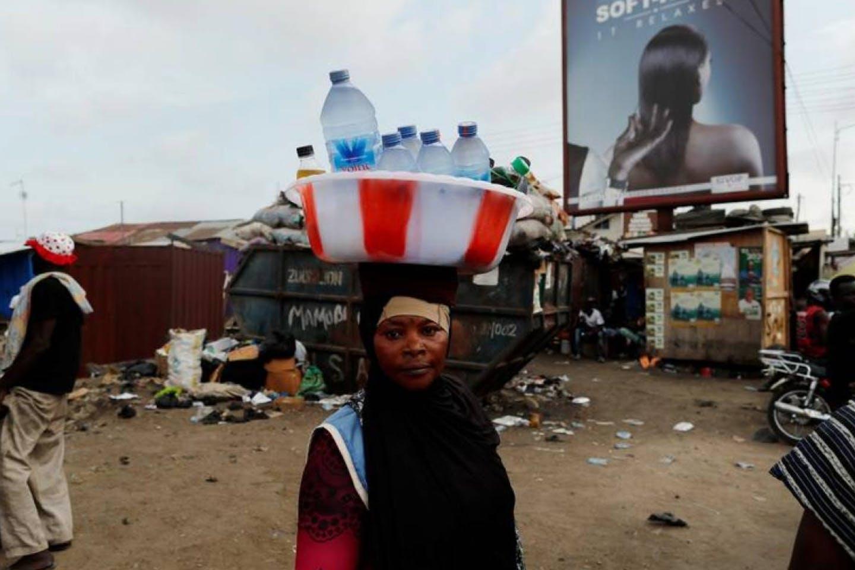 Woman street vendor selling water