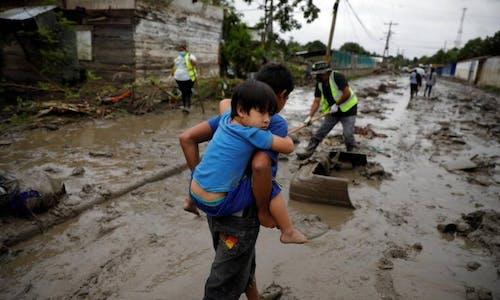 Dark future? Climate change fuels higher heat, flood threats for children