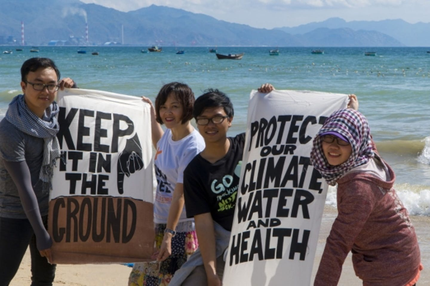 Vietnamese climate campaigners in front of the Vinh Tan coal complex