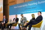 CSRWorks managing director Rajesh Chhabara (centre) sits in between Tim Mohin of GRI and Madelyn Antoncic of SASB at the Asia Sustainability Reporting Summit. Mohin and Antoncic clashed over whose standard was better. Image: Eco-Business
