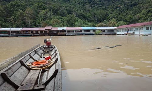 Indigenous communities threatened with legal action by timber giant as flooding devastates Sarawak