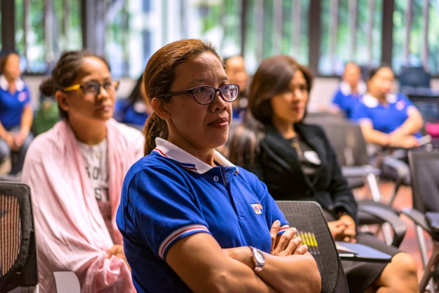 Filipino domestic workers working in Singapore attending a workshop on finance training. Image: UN Women/Staton Winter