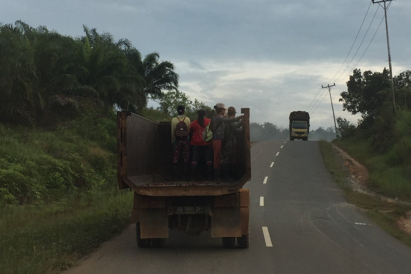 Agricultural workers on their way to a plantation in Western Kalimantan. Image: Robin Hicks/Eco-Business