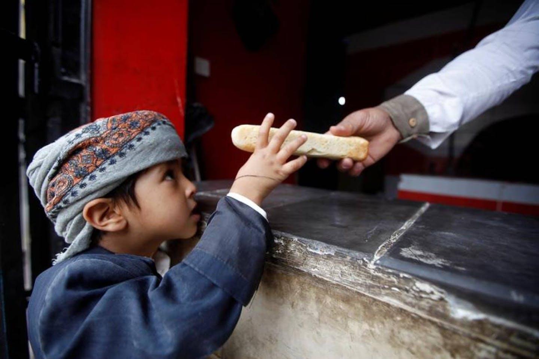 baker gives boy bread in Yemen